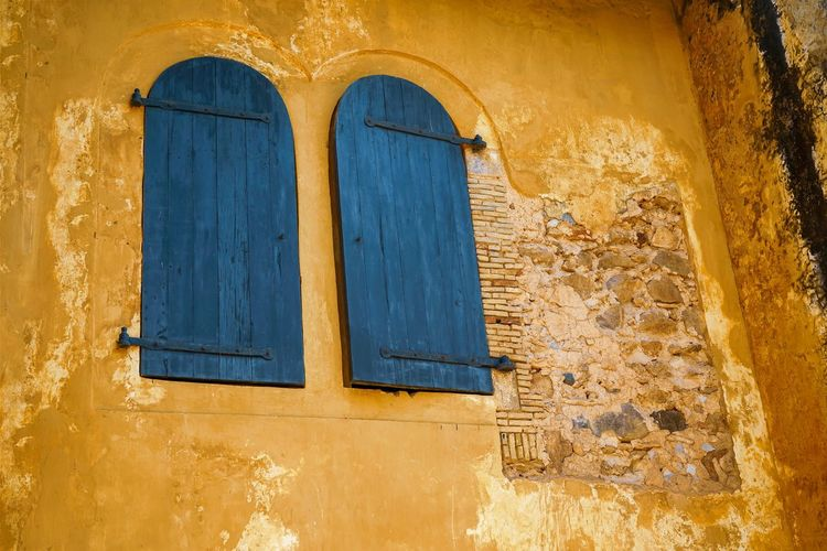 Built Structure Architecture Building Exterior Window Yellow Wall - Building Feature No People Closed Weathered Building Day Arch Old Door Blue Entrance House Outdoors Residential District Close-up