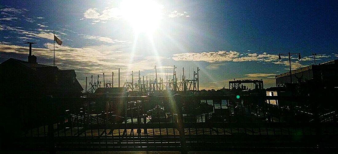 New Bedford Massachusetts Waterfront Port Of New Bedford- Boats Waterfrontview Seafront Port Fishing Boats Fishing Industry Fishing Fishing Port Oceanside Ocean Sunrise Sunshine Sunlight Sunrays Rays Of Light Rays Of Sunshine Rays Of Sun Sunset Flag Flag Pole American Dream
