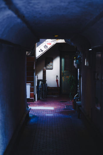 Rear view of person in illuminated building