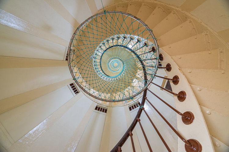 Elliptical staircase seen from below in the amédée lighthouse, amédée island, nouméa, new caledonia