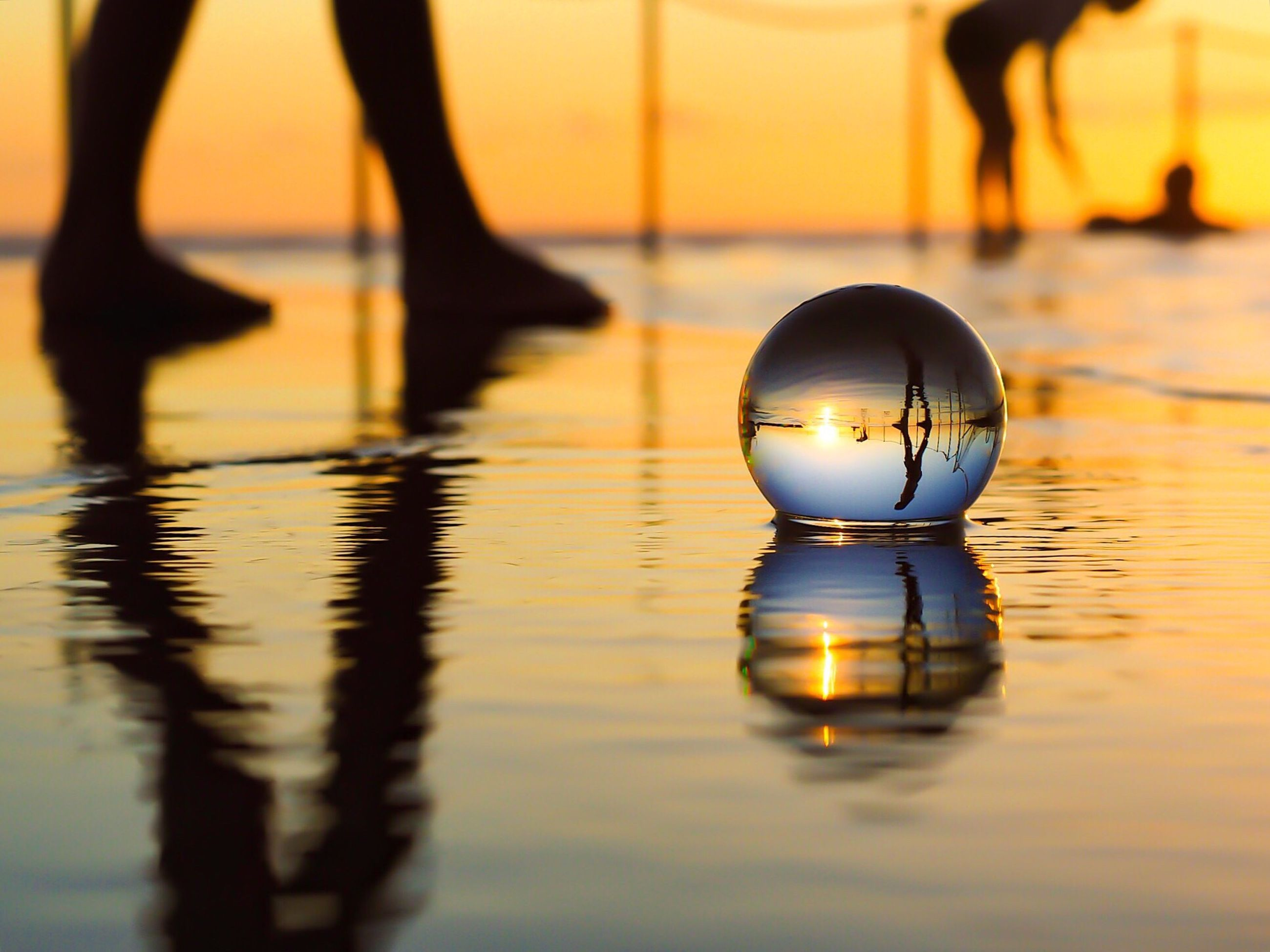 reflection, water, illuminated, sunset, lighting equipment, silhouette, waterfront, mid-air, focus on foreground, dusk, sphere, sky, street light, light bulb, close-up, outdoors, night, ball, electric light, no people