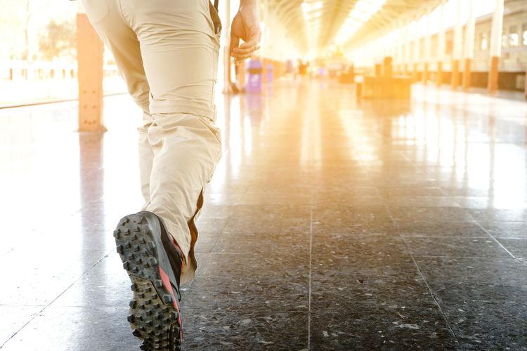 Travel Walk Walking Around Back Lit Body Part Bright Day Flooring Human Body Part Human Leg Low Section Men Motion Nature Outdoors Sport Sunlight Walking