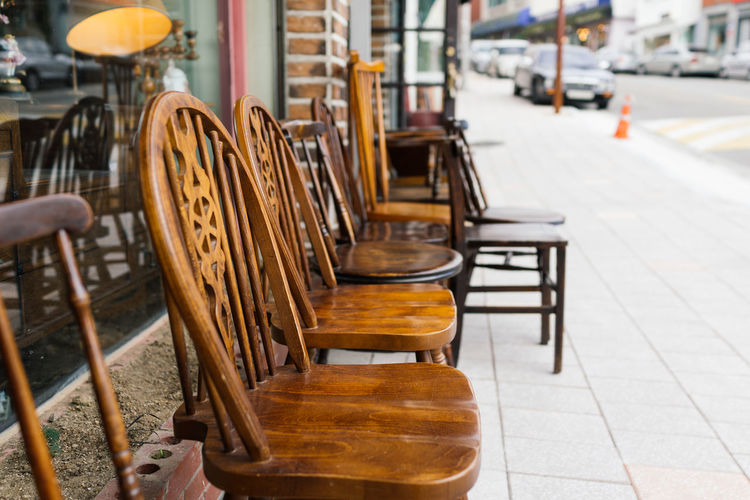 Antique wooden chairs outside shop