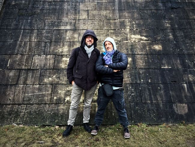 Two cool photographer dudes posing in front of a grunge wall in Berlin Real Real People Wall Men Cool Grunge Berlin Adults Only Outdoors Two People Day Adult Togetherness Black Color Full Length People Standing Friendship Portrait