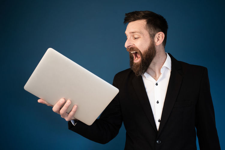 Man using smart phone against gray background