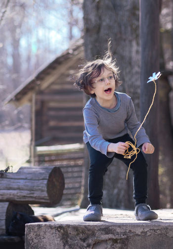 Spring Playing Flower Leisure Activity Rural Life Joy Happiness Emotions Child Full Length Childhood Curly Hair Playing Front View Tangled Hair Preschooler