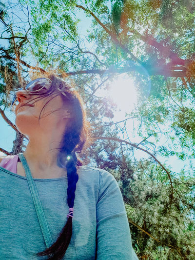 Portrait of teenage girl against tree