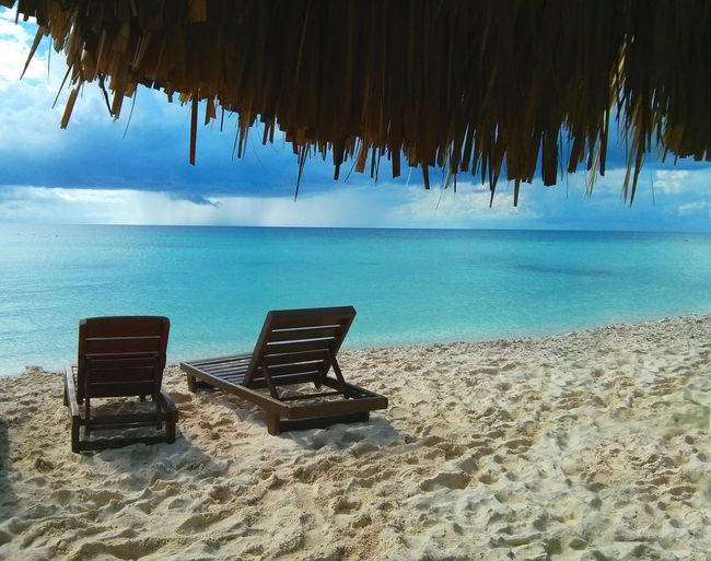 Caribbean Sea Cozumel Mexico Beach Beauty In Nature Caribbean Chair Horizon Horizon Over Water Land Landscape Lounge Chair No People Sand Scenics - Nature Sea Seat Sky Tranqyillity Tropical Turquoise Colored Water