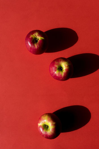 Close-up of red fruit over white background