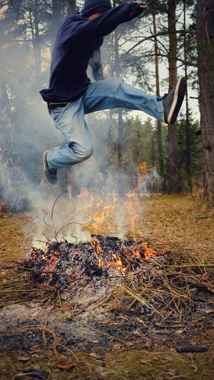 Action Shot  Burning Wood Day Fire Firepit Jumping Jumping Over Fire One Person Outdoors Smoke Spring Teenager Young Adult