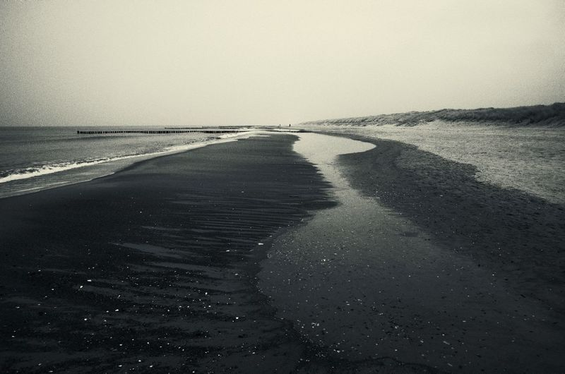 desire Baltic Sea Emptiness Loneliness Winter Beach Beauty In Nature Blackandwhite Clear Sky Day Horizon Over Water Nature No People Outdoors Sand Scenics Sea Seaside Sky Tone Splitting Tranquil Scene Tranquility Water Wave