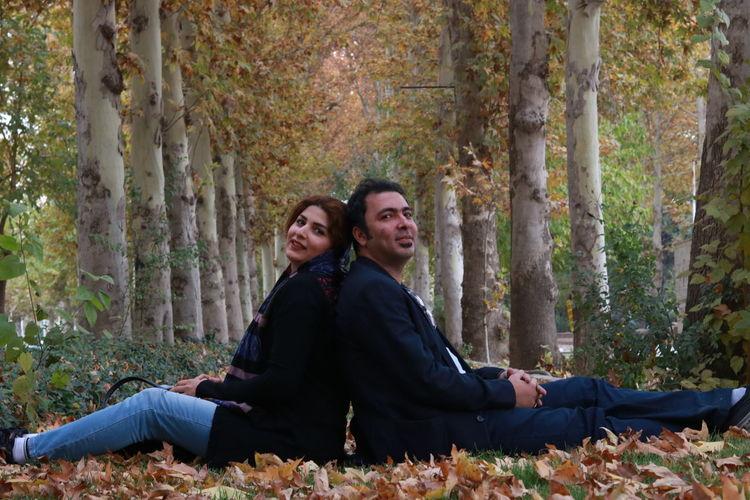 Portrait of couple sitting at park