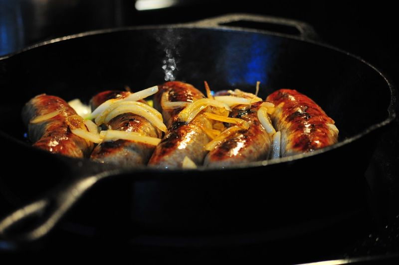 Close-Up Of Sausages In Cooking Pan