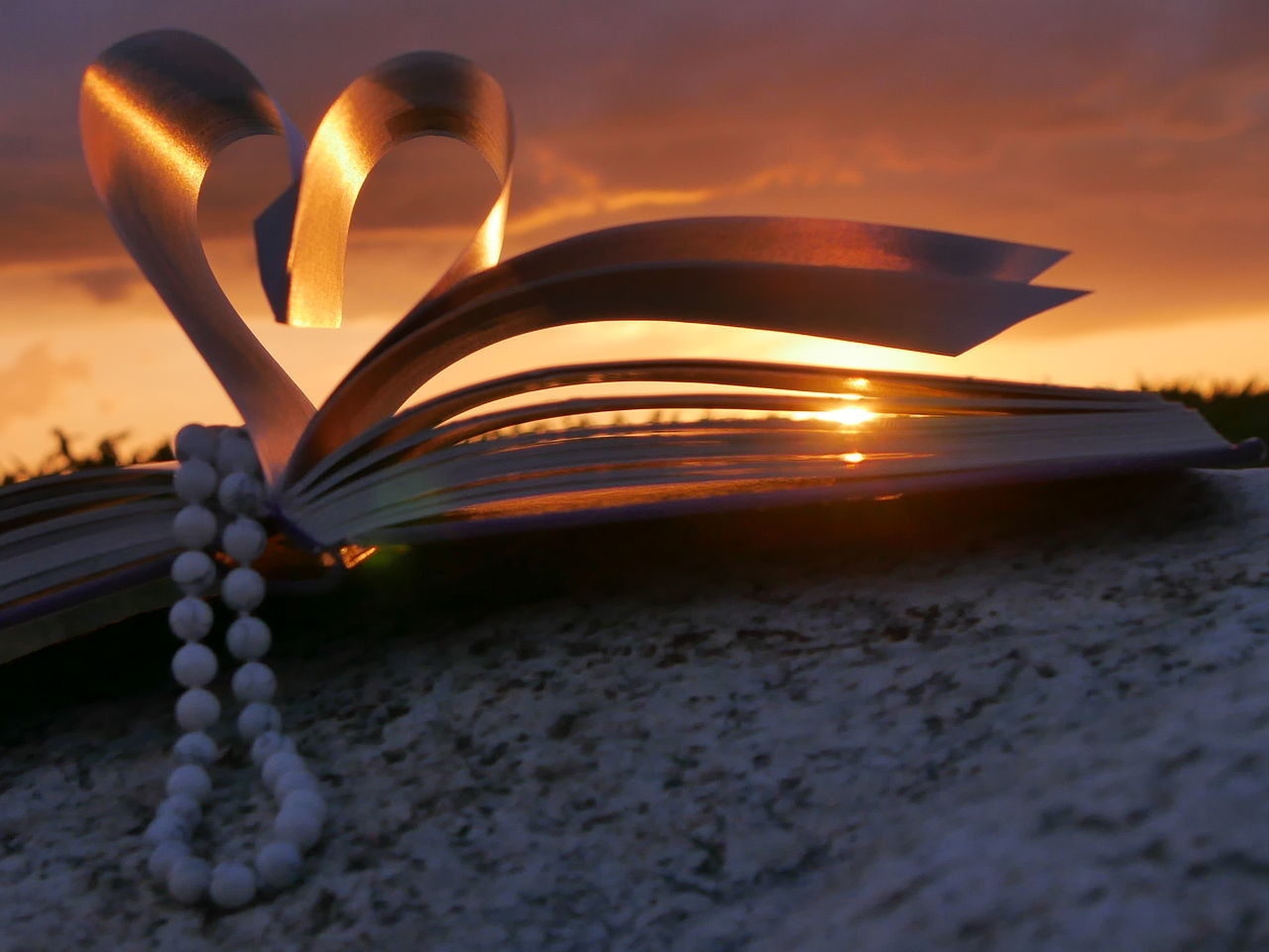 sunset, education, page, book, heart shape, rock - object, wisdom, cloud - sky, outdoors, sky, nature, beauty in nature, no people, close-up