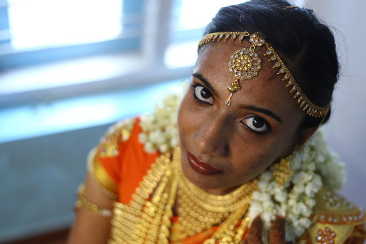 Close-Up Portrait Of Bride Sitting At Home