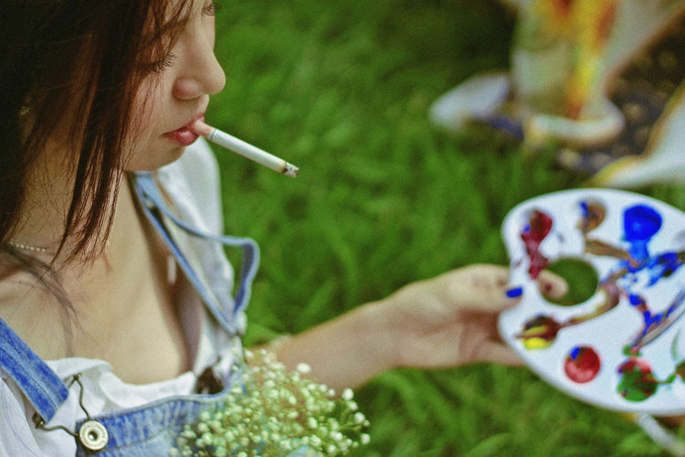 #ProjectNeverland (Lookbook + Food): #VincentvanGogh Nature Smoking Summertime Adult Art Casual Clothing Cigarette  Day Focus On Foreground Hair Hairstyle Headshot Holding Leisure Activity Lifestyles Long Hair One Person Painting Plant Portrait Real People Summer Women Young Adult Young Women The Portraitist - 2018 EyeEm Awards The Creative - 2018 EyeEm Awards Analogue Sound Springtime Decadence