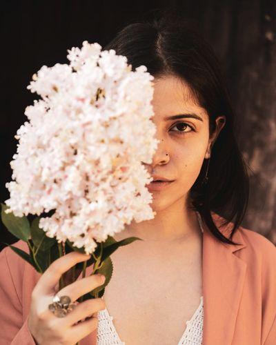 Portrait of a beautiful woman holding flower bouquet