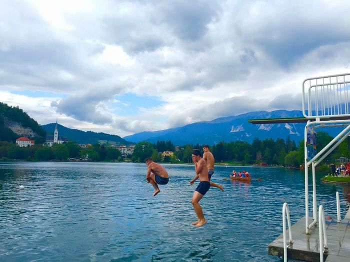 Bled, Slovenia Bonding Cloud - Sky Diving Board Diving Platform Divingphotography Enjoyment Friendship Fun Jumping Lake Bled Lake Bled, Slovenia Leisure Activity Lifestyles Men Mountain Nature Outdoors Shirtless Sky Slovenia Swimming Togetherness Vacations Water
