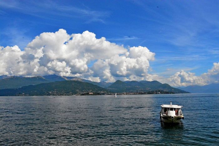 Stresa Italy Beauty In Nature Blue Boat Cloud - Sky Day Mode Of Transport Moored Mountain Nature Nautical Vessel No People Outdoors Scenics Sea Sky Tranquility Transportation Water Waterfront