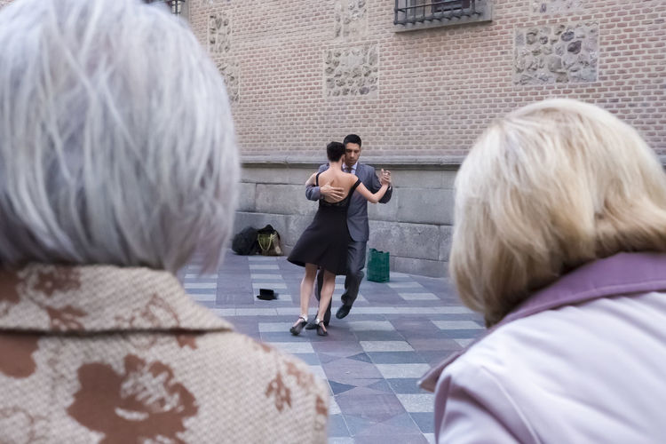 City City Life Fun Street Life Travel Entertainment Full Length Leisure Activity Lifestyles Outdoors People Real People Rear View Street Street Performers Tango Tango Dancers Togetherness Tourism Tourism Destination Travel Destinations Women Young Adult