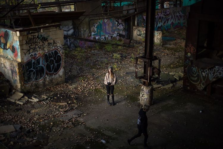 Abandoned Abandoned Places Graffiti Real People Architecture Walking Built Structure Full Length Standing Day Women Outdoors l
