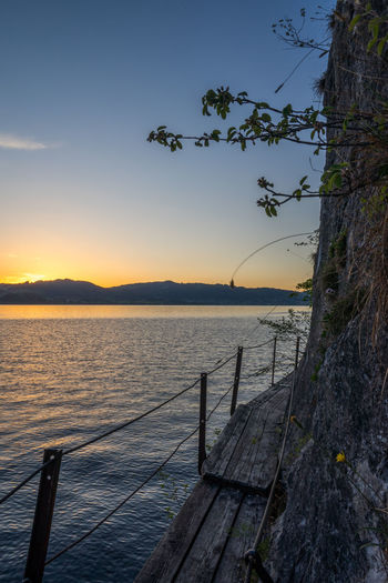 EyeEm Best Shots EyeEm Nature Lover EyeEmBestPics EyeEmNewHere Sunset_collection Beauty In Nature Idyllic Mountain Nature No People Non-urban Scene Outdoors Plant Railing Scenics - Nature Sea Sky Sunset Tranquil Scene Tranquility Traunsee Tree Water Wood - Material Österreich