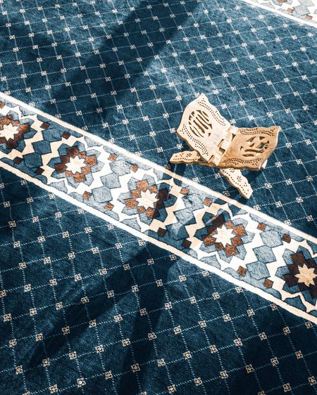 High angle view of rihal on carpet in mosque