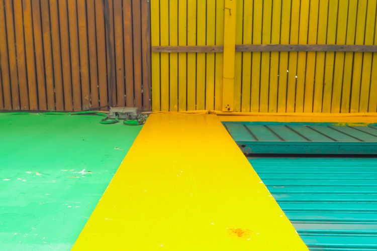 High angle view of yellow wall by swimming pool