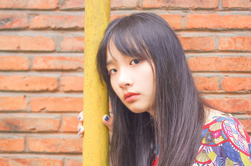 Arts Culture And Entertainment Beautiful People Beauty Brick Wall Headshot Long Hair Portrait Young Adult EyeEmNewHere Women Around The World The Portraitist - 2017 EyeEm Awards