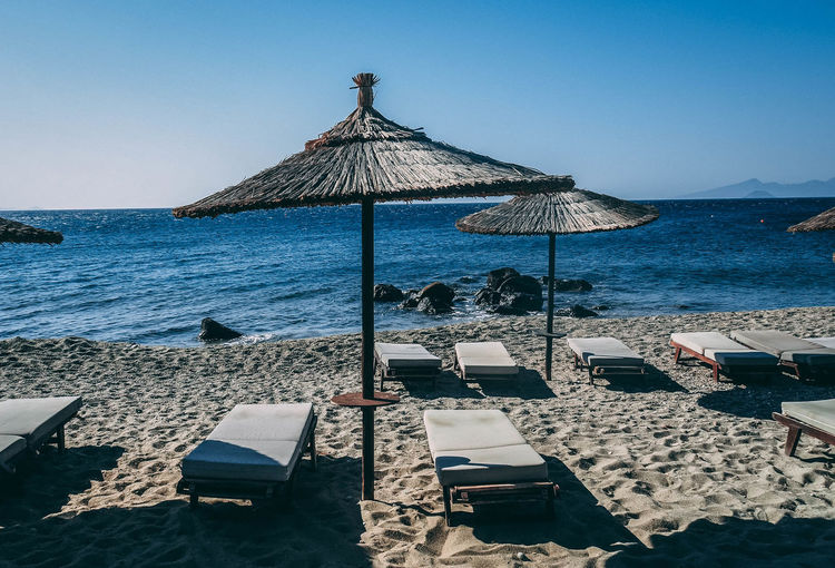 Beach Beauty In Nature Chair Clear Sky Horizon Horizon Over Water Land Lounge Chair Nature No People Outdoors Parasol Roof Scenics - Nature Sea Shade Sky Tranquil Scene Tranquility Umbrella Water