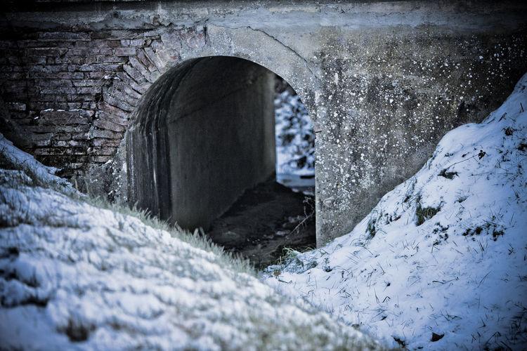 Arch bridge in frozen tunnel