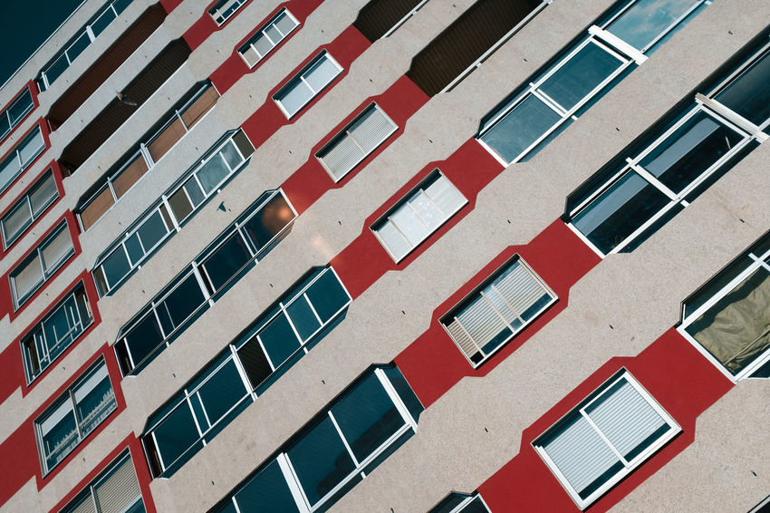 Threeweeksgalicia Built Structure Building Exterior Architecture No People Building Outdoors Window Day Full Frame Red In A Row Backgrounds City Residential District High Angle View Repetition Pattern Technology Side By Side Sunlight Apartment
