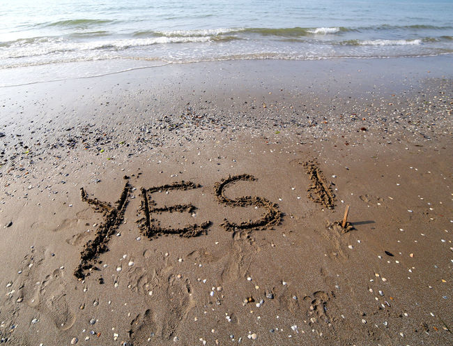 Great YES written on the sand of the sea No Problem Text Yes Beach Capital Letter Confirmation Day Handwriting  Message No Problems Outdoors Perfect Sand Single Word Text Written Yes ! Yes Text