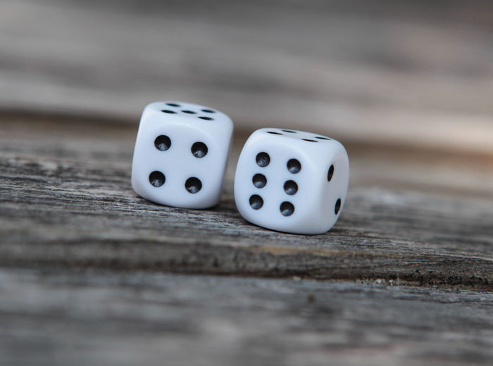 10 Arts Culture And Entertainment Cube Shape Dice Gambling Group Of Objects Leisure Games Luck Number Opportunity Pattern Relaxation Selective Focus Shape Spotted Still Life Surface Level Table Ten Wood - Material