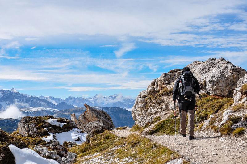 Rear view of man hiking european alps