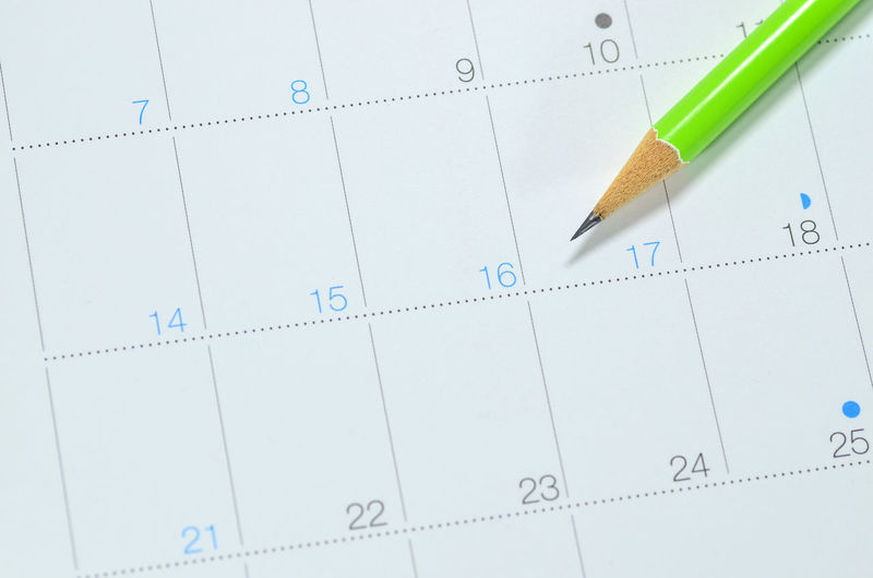High angle view of pencil on calendar