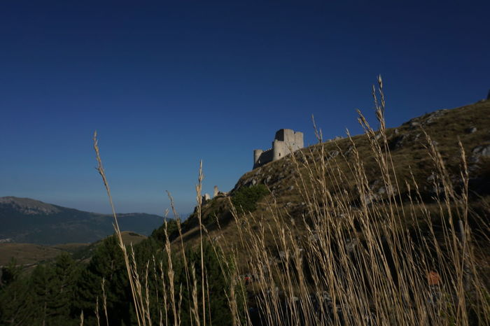 Beauty In Nature Blue Clear Sky Copy Space Growth Ladyhawke Landscape Nature Outdoors Remote Rocca Calascio Tranquil Scene Tranquility Water
