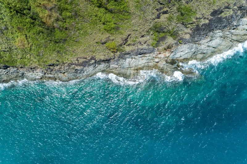 Water Sea Beauty In Nature Scenics - Nature Nature Day No People Rock - Object Rock Blue Solid Turquoise Colored Motion Outdoors Land Waterfront Environment Aquatic Sport Rock Formation Power In Nature Purity