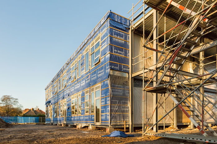 Construction Site wrapped by blue waterproof membrane sheets Architecture Architecture Architecturelovers Building Exterior Built Structure Construction Construction Site Construction Site Construction Work Day Factory Industry No People Outdoors