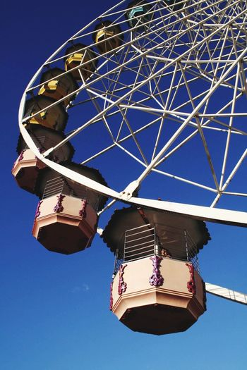 In the. Park Low Angle View Amusement Park Ride Amusement Park Sky Arts Culture And Entertainment Clear Sky Nature Ferris Wheel No People Illuminated Lighting Equipment Enjoyment Blue Day Leisure Activity Outdoors Fairground Hanging Chain Swing Ride Fun