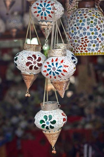 Close-up of decoration hanging in market for sale