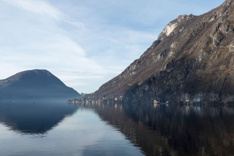 Beauty In Nature Calm Cloud - Sky Day Distant Geology Majestic Mountain Mountain Range Nature No People Non-urban Scene Reflection Remote Rock Formation Scenics Sky Standing Water Tourism Tranquil Scene Tranquility Water Water Surface Waterfront