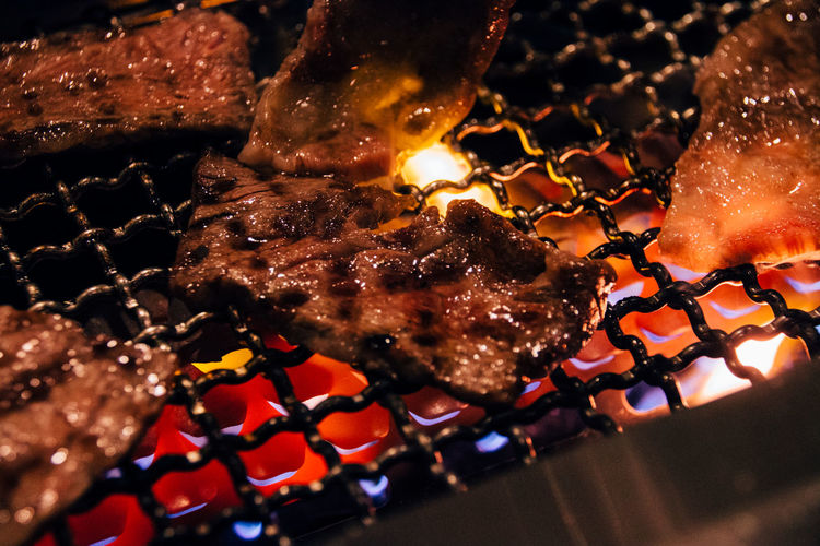 Close-Up Of Meat Cooking In Barbecue Grill