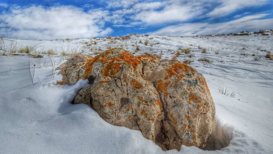 Rocks At Snow Covered Pawnee National Grassland Against Sky