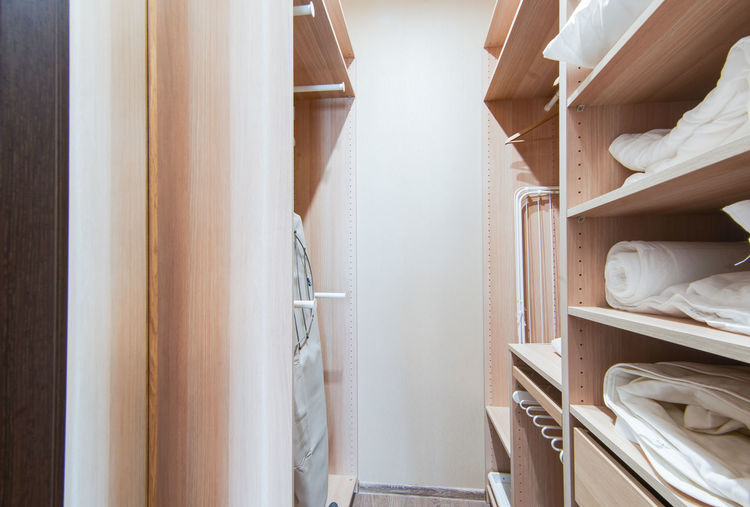Indoors  Shelf No People In A Row Furniture Wood - Material Choice Closet Large Group Of Objects Arrangement Still Life Variation Brown Clothing Shoe Day White Color Textile Collection Absence Clean