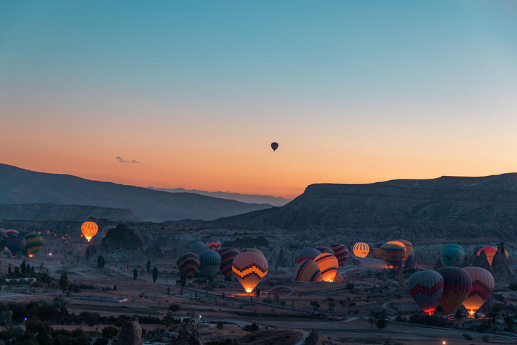 World best hot air balloon destination. Goreme, Turkey. Cappadocia Turkey Sky Mountain Sunset Nature Beauty In Nature Hot Air Balloon Air Vehicle Orange Color Landscape Environment Scenics - Nature Balloon No People Clear Sky Land Mountain Range Travel Tranquil Scene Architecture Non-urban Scene Ballooning Festival