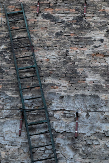 High angle view of ladder on wall