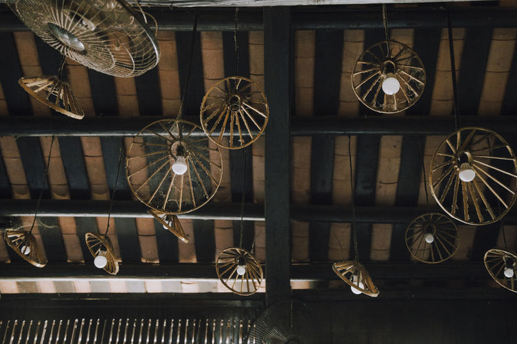 Low angle view of electric fan hanging from ceiling