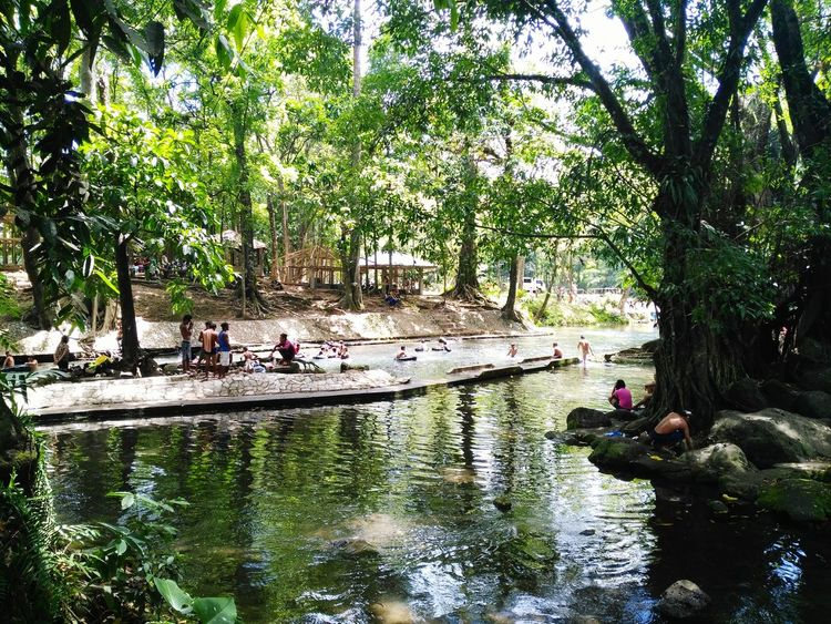 tree reflection large group of people water leisure activity women men nature real people outdoors green color day beauty in nature sky people adult personal perspective itsmorefuninthephilippines choosephilippines Eyeem Philippines Travel Photography