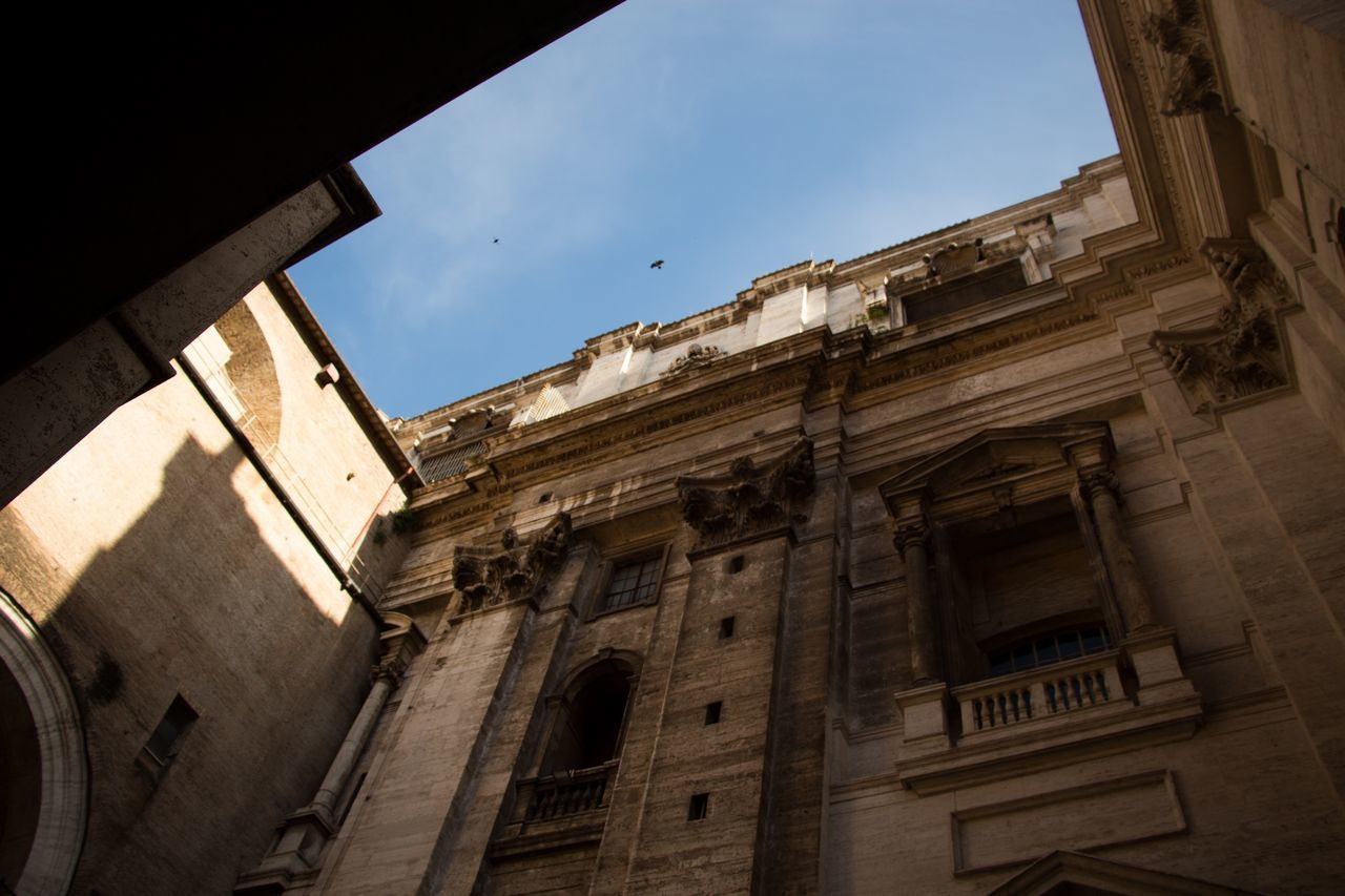 architecture, built structure, building exterior, low angle view, sky, building, window, history, the past, no people, old, day, nature, residential district, outdoors, city, abandoned, sunlight, cloud - sky, arch, ruined, apartment